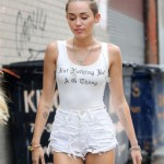 "Miley Cyrus wears a tank top inscribed, ""Ain't Nothing But a G Thang"" when out in about in Brooklyn, NY"